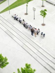 People sitting on a long bench talking (3) - PwC, Photo_RGB_PC_48164.jpg
